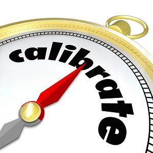 Calibrate word on a gold compass to illustrate the need to change, adjust, align or update your course or direction to achieve your goal or reach your destination
